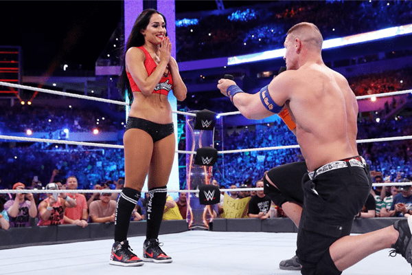 John Cena kneels down to propose to his girlfriend Nikki Bella at WrestleMania
