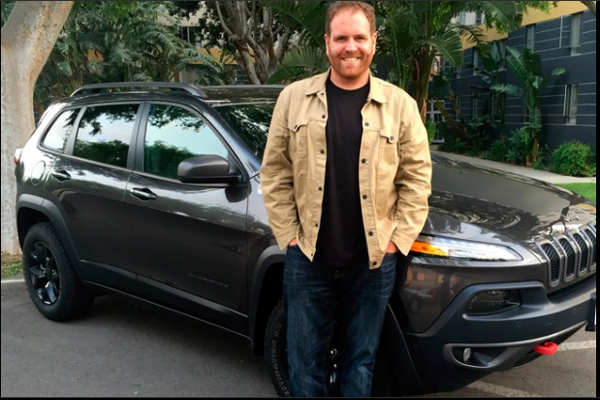 Josh Gates with his car