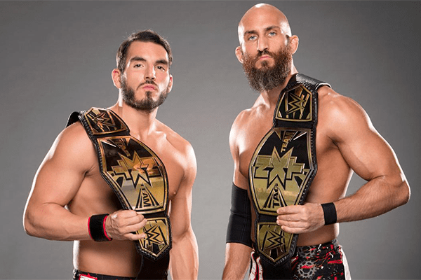 Tomaso Ciampa (Right) former teammate of Johnny displaying their NXT Tag team champions belt, who later on betrayed him.