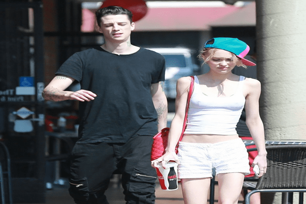 A picture of Ash Stymest & Lily Rose Depp making an appearance together