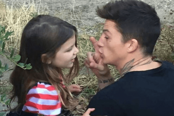 A picture of English Male model Ash Stymest with his daughter Summer Stymest