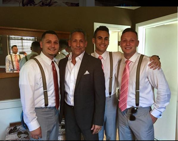 Angelo Pagan with his three son