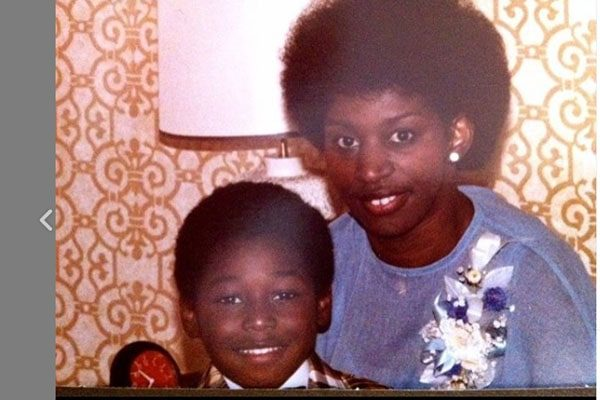 Adrian Holmes and his mother